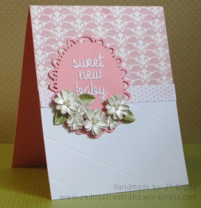 Sweet new baby card with homemade flower embellishments.